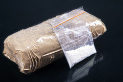 Cocaine powder. In plastic bag with a packages Stock Photos