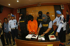 Cocaine smugglers. Customs officers arrest smugglers of cocaine in the city of Solo, Central Java, Indonesia Stock Photo