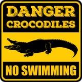 Coccodrilli del pericolo nessun segno di nuoto illustrazione di stock