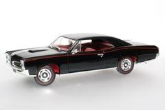 Coche 1966 del juguete de la escala del metal de Pontiac GTO Imágenes de archivo libres de regalías