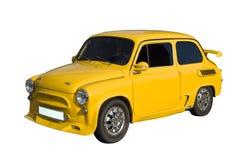 Coche amarillo de la vendimia Fotos de archivo