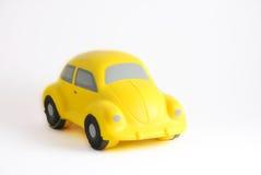Coche amarillo del juguete Foto de archivo libre de regalías
