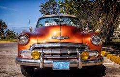 Coche americano clásico anaranjado Fotografía de archivo libre de regalías