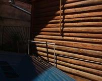 Coche azul cerca de la cabaña de madera Fotos de archivo libres de regalías