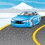 Coche azul en el camino Imágenes de archivo libres de regalías