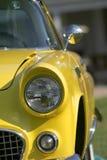 Coche clásico amarillo Imagenes de archivo