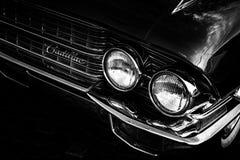 Coche clásico de Cadillac blanco y negro Fotos de archivo