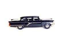 Coche cobrable del negro del modelo del juguete fotos de archivo