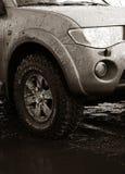 Coche con las ruedas del Fango-terreno Imagen de archivo