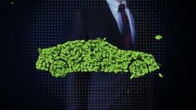 Coche conmovedor del verde del eco del hombre de negocios hecho de las hojas Hojas almacen de video
