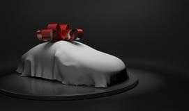 coche 3D envuelto bajo una hoja y arco rojo grande Imágenes de archivo libres de regalías