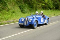 Coche de BMW que corre en la raza de Mille Miglia Fotografía de archivo libre de regalías