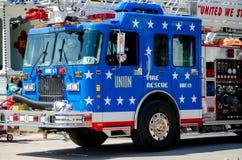 Coche de bomberos azul colorido Imágenes de archivo libres de regalías