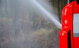 Coche de bomberos en la acción Fotos de archivo