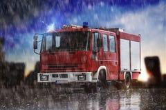 Coche de bomberos llano en componer de la lluvia fotos de archivo