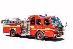 Coche de bomberos rojo aislado Imagenes de archivo
