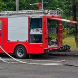 Coche de bomberos y equipos Imagen de archivo libre de regalías