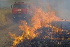 Coche de bomberos y llama 1 fotografía de archivo libre de regalías