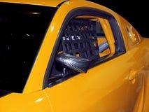 Coche de carreras amarillo Fotos de archivo libres de regalías