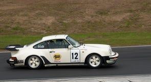 Coche de competición de Porsche 930 Turbo a la velocidad Imágenes de archivo libres de regalías