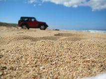 Coche de cuatro ruedas en la arena Fotografía de archivo libre de regalías