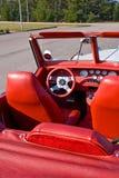 Coche de cuero rojo de la vendimia Foto de archivo libre de regalías