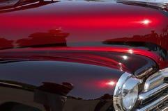 Coche de encargo rojo y marrón Imagen de archivo libre de regalías