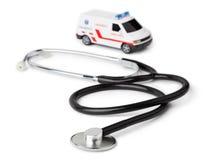 Coche de la ambulancia del estetoscopio y del juguete Imagen de archivo libre de regalías