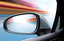 Coche de la velocidad en el camino Imagen de archivo libre de regalías