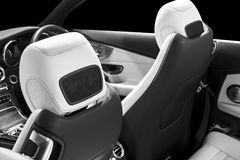 Coche de lujo moderno dentro Interior del coche moderno del prestigio Asientos de cuero cómodos Cuero perforado con el backg negr foto de archivo