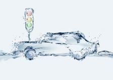 Coche del agua y semáforo Fotografía de archivo