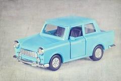 Coche del juguete de la vendimia con corregir textured Fotos de archivo