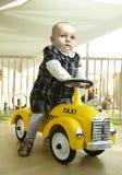 Coche del juguete del montar a caballo del bebé Fotografía de archivo libre de regalías