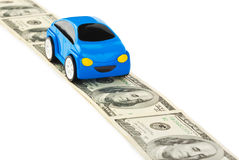 Coche del juguete en el camino del dinero Imagen de archivo