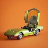 Coche del juguete en fondo anaranjado Imagenes de archivo