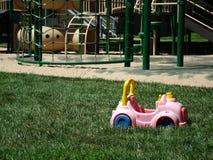 Coche del juguete en patio Imágenes de archivo libres de regalías