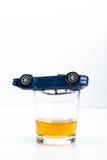 Coche del juguete y vidrio de whisky Foto de archivo