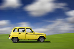 Coche divertido amarillo Foto de archivo libre de regalías