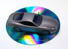 Coche en el CD Foto de archivo