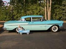 Coche grande poco coche Imagen de archivo