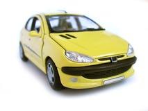 Coche modelo amarillo - ventana trasera. Manía, colección. Imagen de archivo