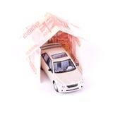 Coche modelo en la casa de billetes de banco Imágenes de archivo libres de regalías