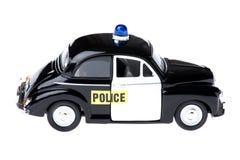 Coche policía del juguete en blanco Fotografía de archivo
