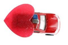 Coche policía rojo en día de tarjetas del día de San Valentín foto de archivo libre de regalías
