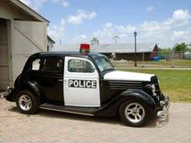 Coche policía viejo fotos de archivo