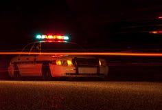 Coche policía en la noche Imágenes de archivo libres de regalías