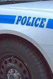 Coche policía. Verticalmente. Fotos de archivo