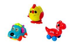 Coche, pollo, juguete dinosuar aislado foto de archivo libre de regalías