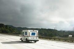 Coche postal en la carretera Imagen de archivo libre de regalías