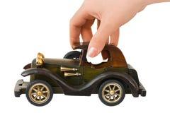 Coche retro de la mano y del juguete Imagenes de archivo